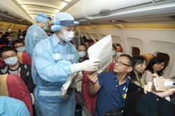 Medical staff accesses other passengers that might have come into close contact with the sick patient.