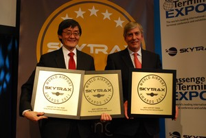 Howard Eng (left), AA's Executive Director, Airport Operations, is delighted to receive three awards including the World's Best Airport award from Edward Plaisted (right), Skytrax's Chairman, in Copenhagen.